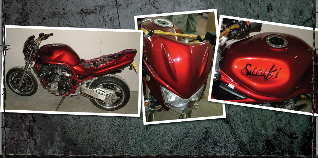 Suzuki bandit refinished in red candy with scrawly lettering