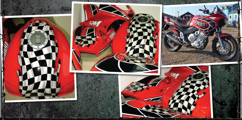 Yamaha TDM in red with wavey checkered flag
